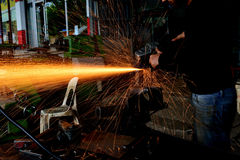 Chopping metal worker in the factory Royalty Free Stock Image