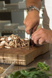 Chopping the mushrooms Royalty Free Stock Photography