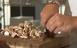 Chopping the mushrooms Royalty Free Stock Images