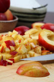 Chopping nectarines Stock Photography