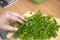 Chopping parsley Royalty Free Stock Photos