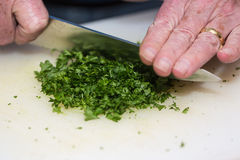 Chopping parsley Stock Photo
