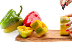 Chopping Peppers On Board Stock Photo