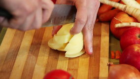 Chopping a potato on a board stock video