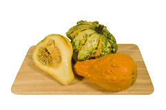 Chopping pumpkins. Squashes of colors and sizes on a chopping Stock Photography