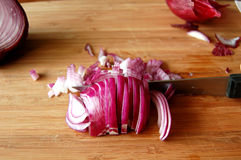 Chopping red onions Royalty Free Stock Images