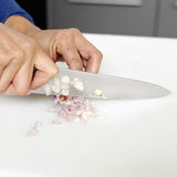 Chopping a shallot Stock Images