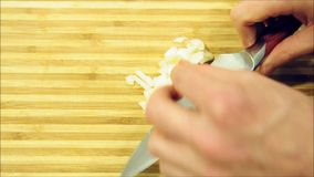 Chopping and slicing garlic video stock video footage