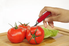 Chopping of tomato Royalty Free Stock Photos