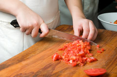 Chopping the tomato Royalty Free Stock Image
