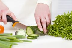 Chopping Vegetable to a Healthy Salad Royalty Free Stock Photos
