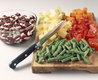 Chopping the vegetables Stock Images