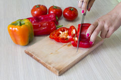 Chopping vegetables in the kitchen Stock Image