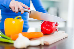 Chopping Vegetables in the Kitchen Stock Photography