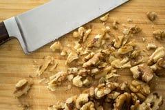 Chopping walnuts, close up Stock Photos