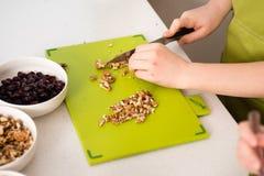 Chopping walnuts Stock Photo