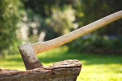 Chopping wood. Axe for chopping wood embedded in a tree stump royalty free stock photo