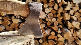 Chopping wood with an ax..background. Royalty Free Stock Image