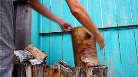 Chopping wood with axe stock video