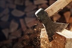 Chopping wood with axe - closeup on flying wooden chips - copy s Stock Photography