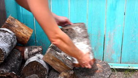 Chopping wood with axe stock footage