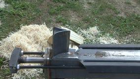 Chopping wood hydraulic log splitter stock video footage