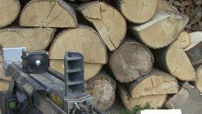 Chopping wood hydraulic log splitter, front view stock video