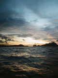 Choppy sea at dusk. Dusk of a stormy day in Philippines, after a typhoon had left Stock Photo