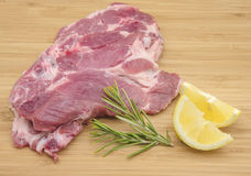 Chops raw. Pork ready to cook them Royalty Free Stock Photo