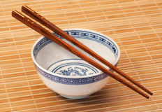 Chopstick on bamboo Stock Images