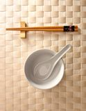 Chopstick and bowl. Chopstick and empty white bowl with texture background royalty free stock photos