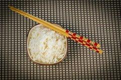 Chopstick and bowl of rice Stock Photos