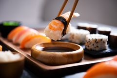 Chopstick with nigiri sushi piece stock photo