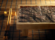 Chopstick and seaweed. Chopstick and dry seaweed with texture background royalty free stock image