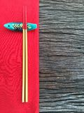 Chopstick on wood and red table cloth. Texture royalty free stock images