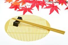 chopsticks ανασκόπησης απομόνωσαν & Στοκ Φωτογραφίες
