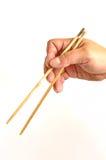 chopsticks χέρι Στοκ Φωτογραφία