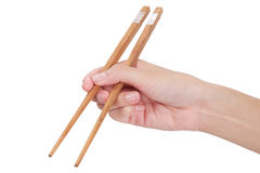 chopsticks χρησιμοποίηση χεριών Στοκ Φωτογραφίες