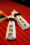 Chopsticks. Wrapped in napkins, shallow depth of field Royalty Free Stock Photos
