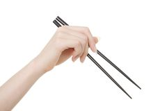 Chopsticks. Studio shot of hand holding chopsticks on white background royalty free stock photo