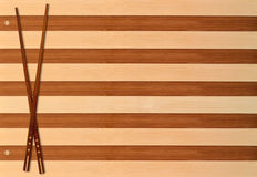 Chopsticks. Two chopsticks on a bamboo mat Royalty Free Stock Photography