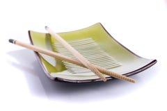 Chopsticks. Wooden chopsticks on a plate on white background Stock Photography