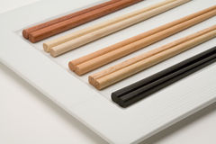 Chopsticks. Different sets of chopsticks on a white plate royalty free stock photo