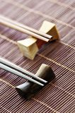 Chopsticks. Two sets of wooden chopsticks on rests close up Stock Image