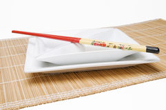 Chopsticks on angular dish parallel Stock Photos