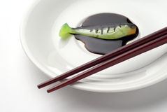 Chopsticks with artificial fishing bait Stock Photography