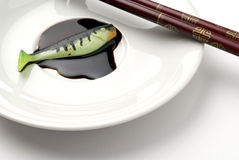 Chopsticks with artificial fishing bait Royalty Free Stock Photography