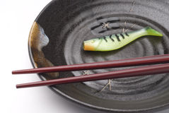 Chopsticks with artificial fishing bait Royalty Free Stock Photo
