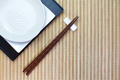 Chopsticks in asian set table Stock Photos