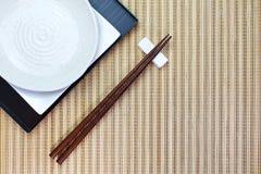 Chopsticks in asian set table Stock Photos